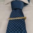 Aranyozott nyakkendőtű